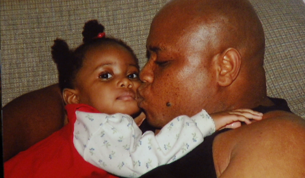 Patrick Sawyer in an undated photo with his daughter. Photo via theepochtimes.com