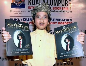 Adi Putra Abdul Ghani math genius with his book. Image from The Star