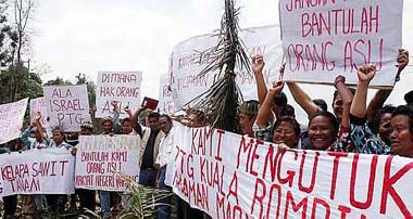 It's all about give and take with the Orang Asli. We give no thought to their rights and take away their land. Image from revolutionaryfrontlines.files.wordpress.com.