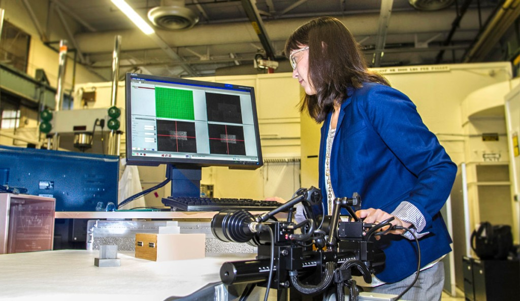 Lawrence Livermore National Laboratory researcher Amanda Wu performing her stress test. Image from 3D Printing Industry.