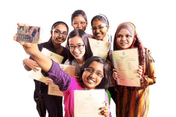 PT3 students who are happy with their results. Image from The Star.