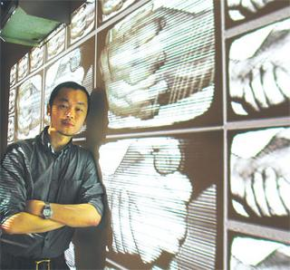 Leon Lim with a multimedia piece called Silent Story at the John F. Kennedy Centre, Washington. Image from New Straights Times