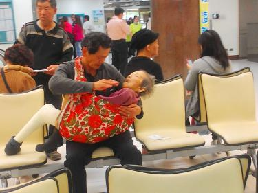 Photo of a filial son taking care of his mother in Taiwan. Photo from taipeitimes.com