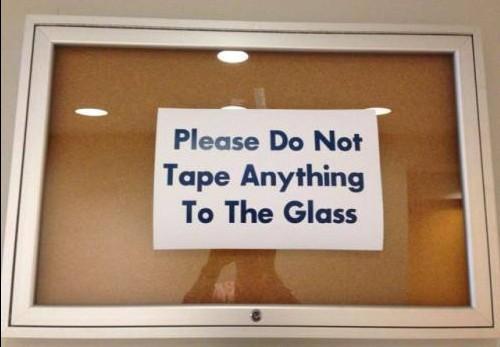 ironic-tape glass notice