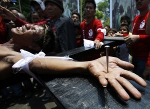 Taken from http://www.themalaysianinsider.com/world/article/filipinos-nailed-to-cross-in-easter-ritual-frowned-on-by-church