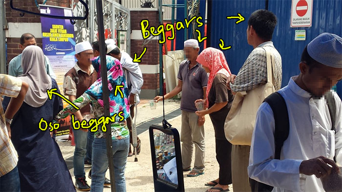 Beggars in Masjid Jamek. Click to read
