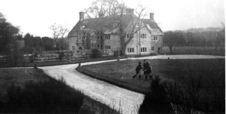 Almer-Manor-BB007's-UK-home-with-his-children-playing-on-the-lawn