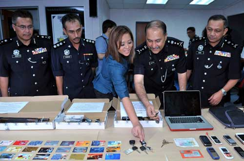 police seize confiscate laptop computer