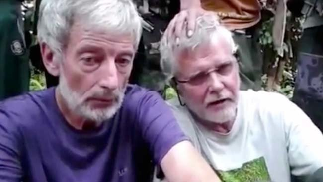 Robert Hall (left) and John Ridsel Canadian hostages beheaded by Abu Sayyaf. Image from The Canadian Press