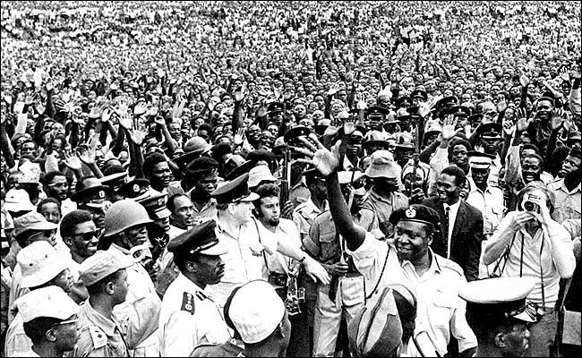 ** FILE **Maj. Gen. Idi Amin waves to thousands of Ugandans gathered in a ceremony following the release of 55 political prisoners in Kampala, Uganda, in this January1971 file photo. Amin, whose eight years as president of Uganda were characterized by bizarre and murderous behavior, died Saturday, Aug. 16, 2003, according to a hospital official in Saudi Arabia. Amin was 80. (AP Photo/File) ORG XMIT: NY16
