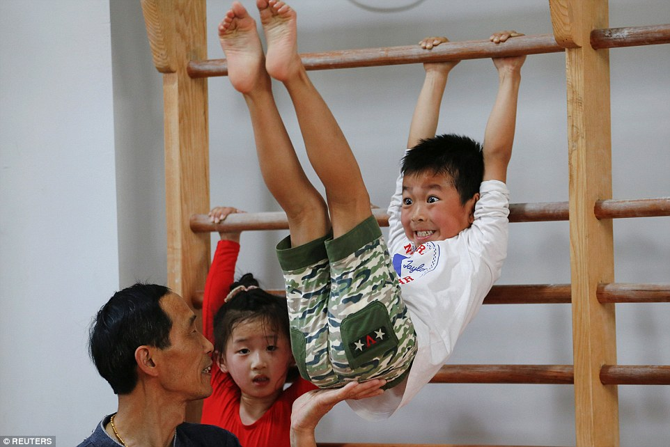 China children olympics torture training gymnastics Image from Daily Mail