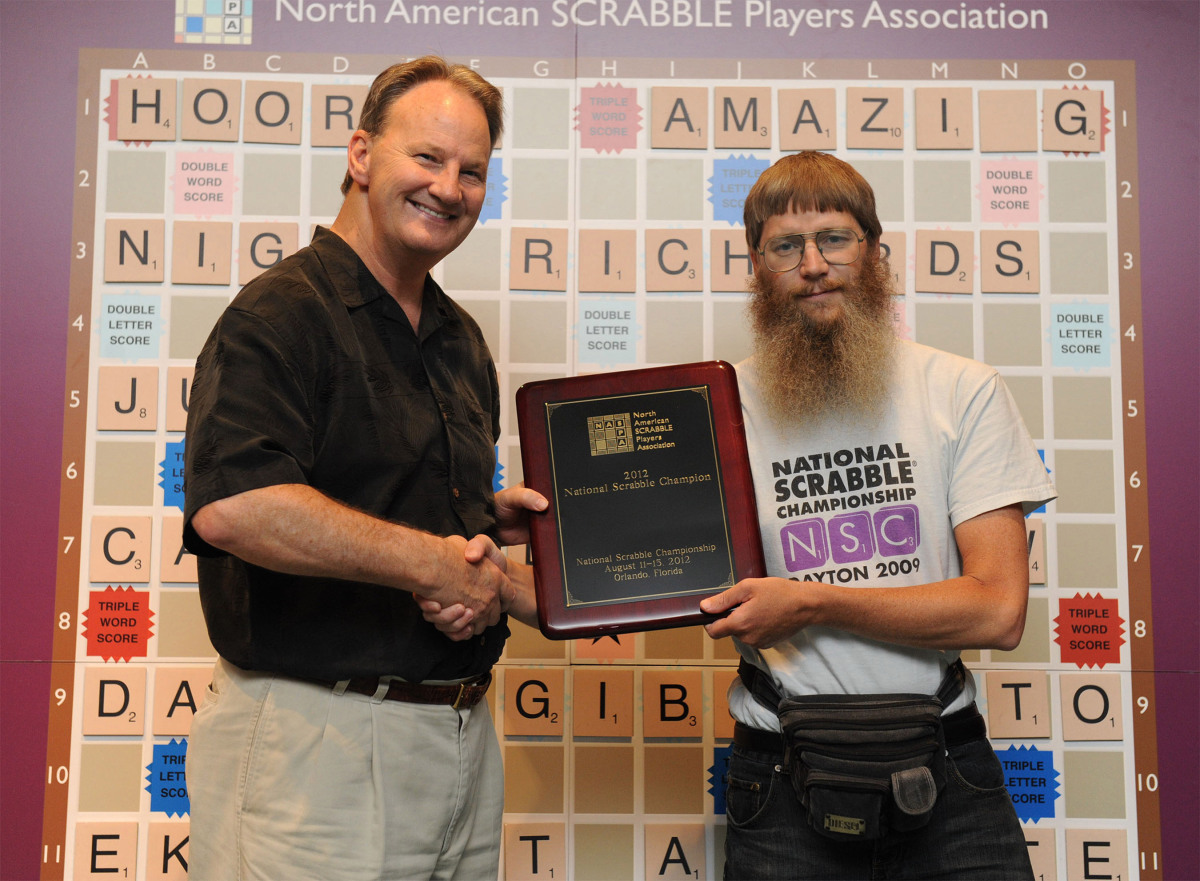 Nigel Richards (right) with Chris Cree, co-president of North American SCRABBLE Players Association, became the only person to win four National SCRABBLE Championships as well as win three titles in a row. As the 2012 National SCRABBLE Champion Nigel won the top $10,000 prize. (PRNewsFoto/National SCRABBLE(R) Championship) THIS CONTENT IS PROVIDED BY PRNewsfoto and is for EDITORIAL USE ONLY**