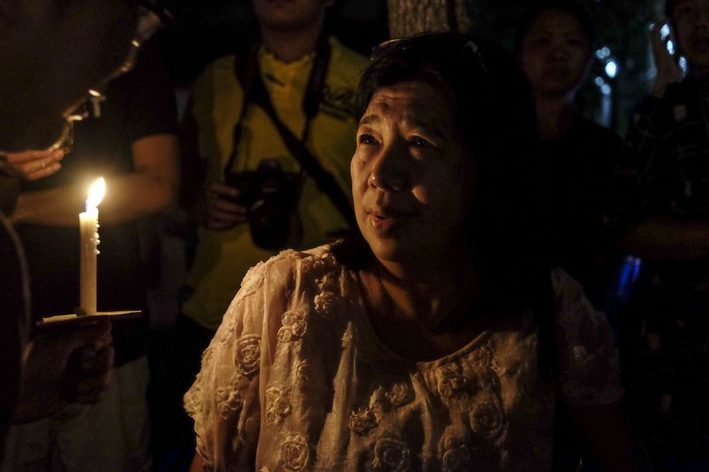 Susanna Liew, the wife of Pastor Koh attending her husband's vigil. Source