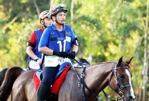 Sultan Mizan on a horse. Source