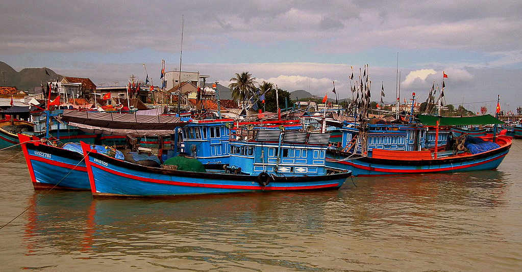Vietnamese fishing boats in a harbor in Nha Trang. Photo from wiki commons.