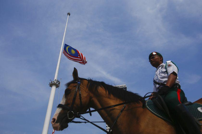 Gas prices naik, flag tak boleh naik?! Photo from Reuters