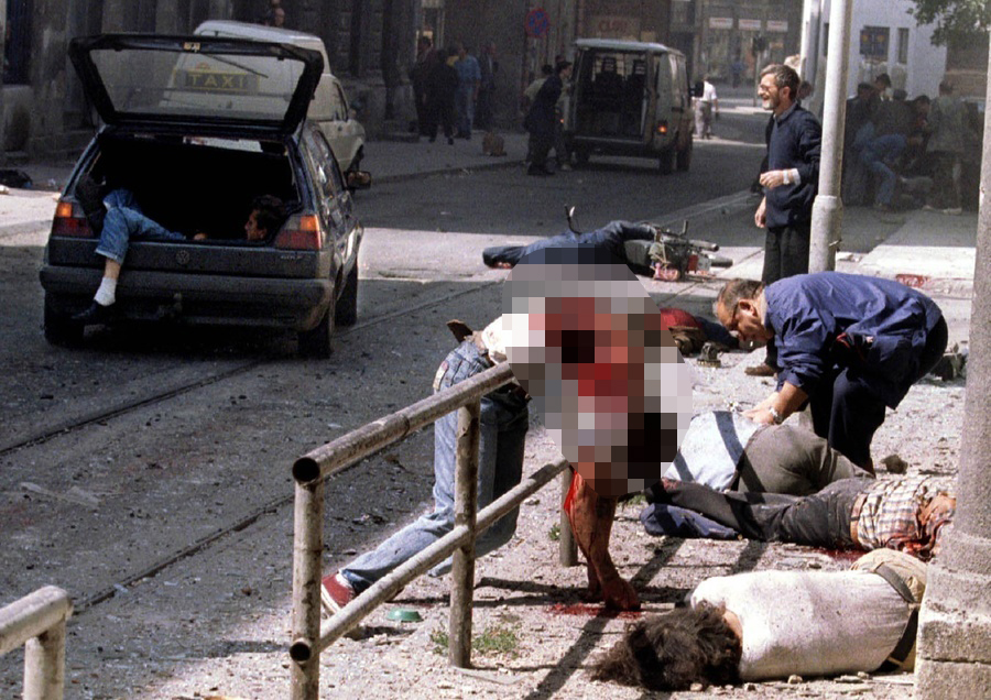 Victims of indiscriminate shelling of cities and towns outside a market in Sarajevo. To see the uncensored image, visit The Atlantic.