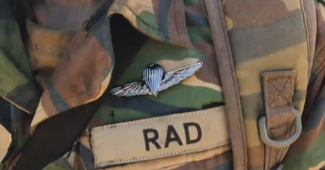 It is said that this special badge (Sayap Berdarah) is granted through the blood wings ritual: the badge is punched into the recruit's chest, causing the pins to pierce the flesh and drawing blood. Img from PencuriVideo.