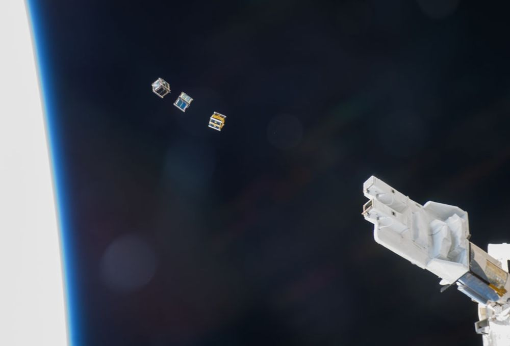 CubeSats being deployed into orbit, but imagine more of them in the background. Img from Popular Science.