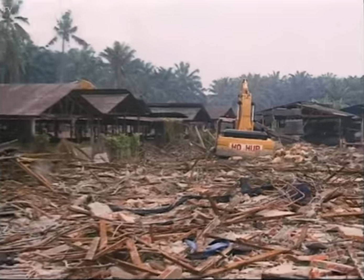 The ruins of Kg Sungai Nipah after the incident. Screengrabbed from the Journeyman Pictures documentary.