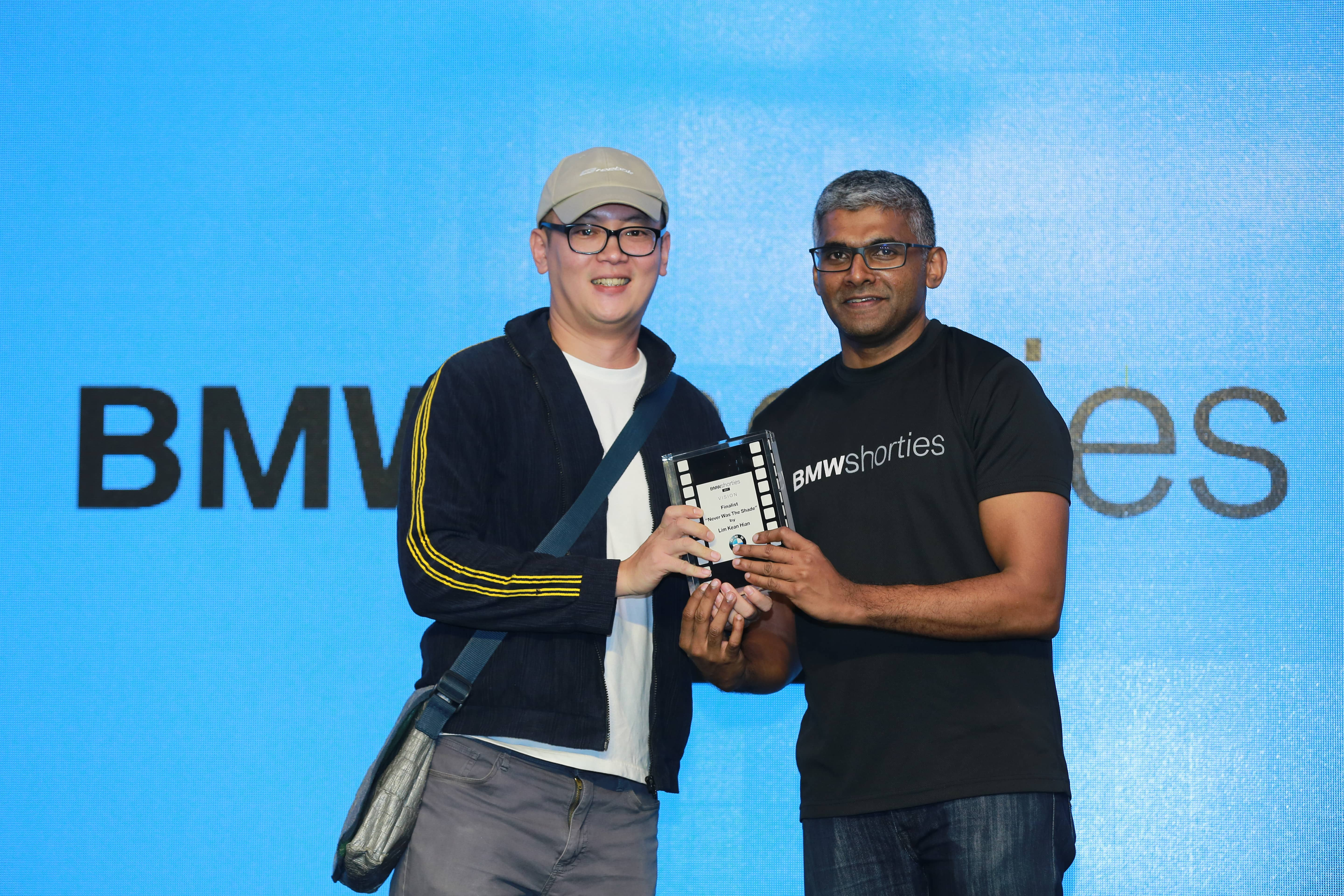 Director of 'Never Was The Shade', Lim Kean Hian, accepting his award for the best short film. Image from BMW Shorties