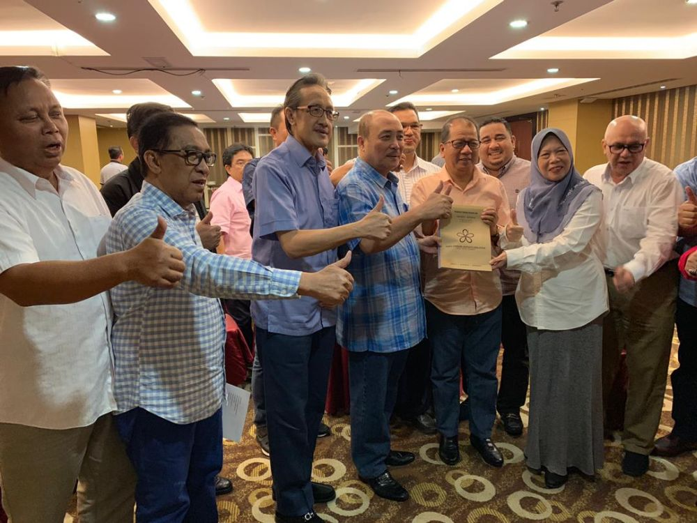 Some of the former Sabah UMNO leaders with allegedly Bersatu application papers. Image from Malay Mail