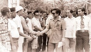 Datuk Abdul Rahim Bakar at a welcoming ceremony greeting the people from a kampung.