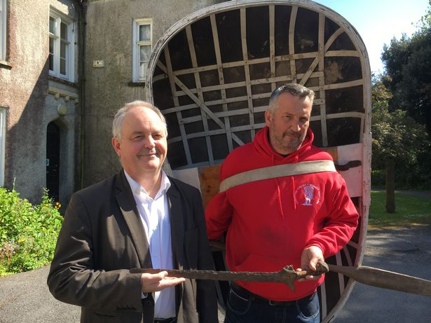 Gavin (left) and Andrew with the mysterious dagger. Img from Wales Online