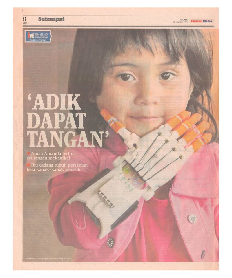 A newspaper clipping of Ainaa's 3D arm. Img from Delta Bionic's Facebook