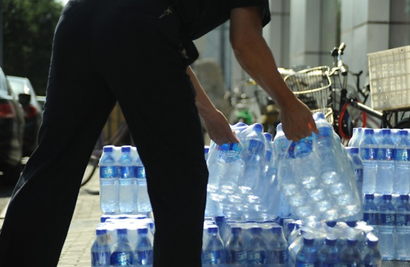 And also the plastic sheets used to wrap the packs of bottles. Image from The Malaysian Times.