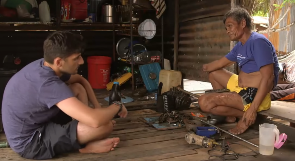 Zand interviews a fisherman who blew his arm off trying out fish bombing. Image from Meeting Malaysia's Fish Bombers