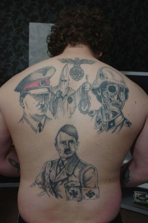 This is Fat Hitler, a neo-Nazi in the UK who has his back tattooed with neo-Nazi symbolism. Hehe, Nazi Lemak. Image from Express.co