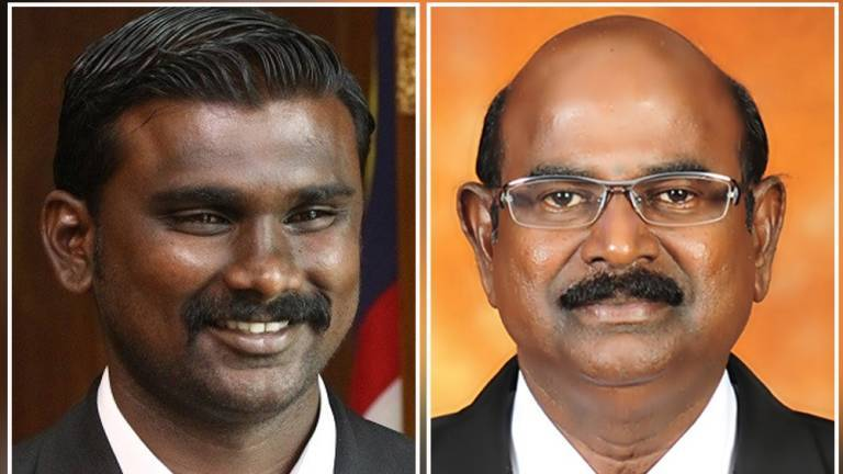 From left: Saminathan and Gunasekaran. Img from The Sun Daily.